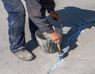 Worker Apply Layer Of Bonding Adhesive 2